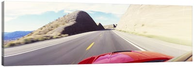 Car on a road, outside Las Vegas, Nevada, USA Canvas Art Print
