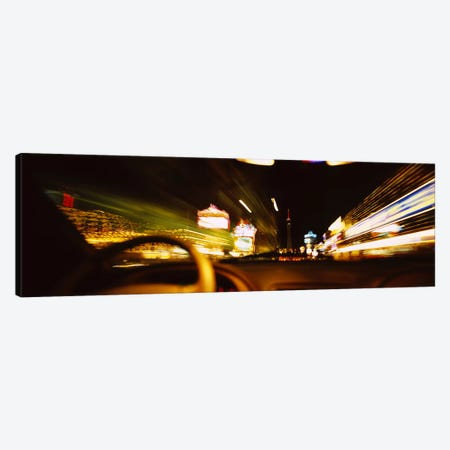 Car on a road at night, Las Vegas, Nevada, USA Canvas Print #PIM6312} by Panoramic Images Canvas Art