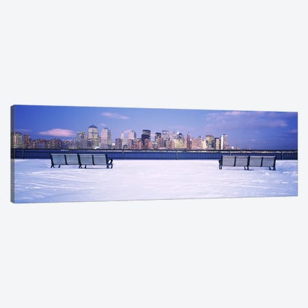 Park benches in snow with a city in the background, Lower Manhattan, Manhattan, New York City, New York State, USA Canvas Print #PIM6333} by Panoramic Images Canvas Wall Art