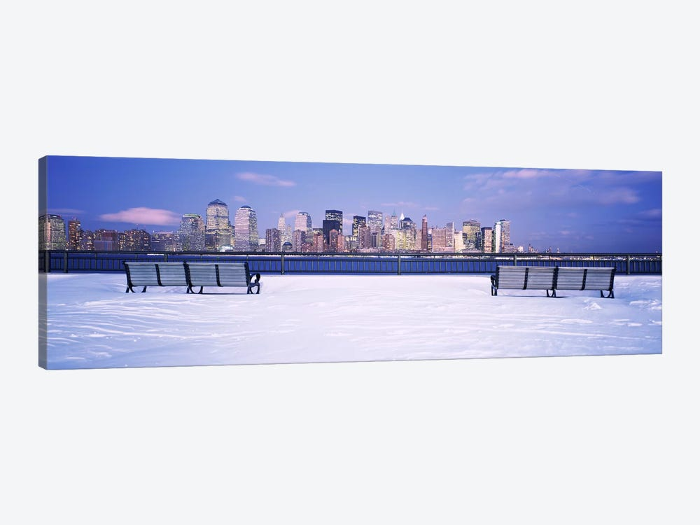 Park benches in snow with a city in the background, Lower Manhattan, Manhattan, New York City, New York State, USA by Panoramic Images 1-piece Canvas Artwork