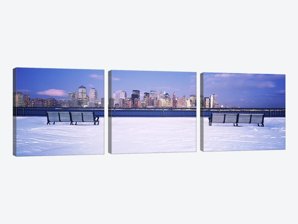 Park benches in snow with a city in the background, Lower Manhattan, Manhattan, New York City, New York State, USA by Panoramic Images 3-piece Canvas Artwork