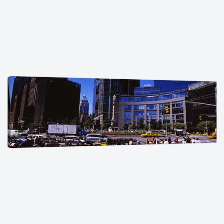 Traffic on the road in front of buildings, Columbus Circle, Manhattan, New York City, New York State, USA Canvas Print #PIM6362} by Panoramic Images Art Print
