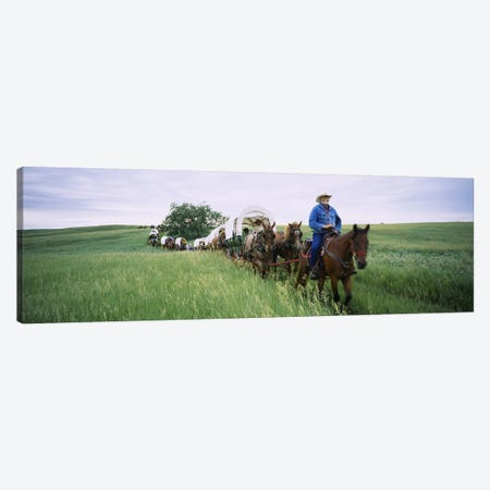 Historical reenactment of covered wagons in a field, North Dakota, USA Canvas Print #PIM6385} by Panoramic Images Canvas Wall Art