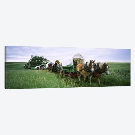 Historical reenactment, Covered wagons in a field, North Dakota, USA Canvas Print #PIM6386} by Panoramic Images Canvas Art
