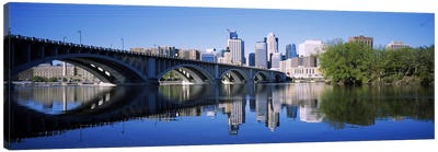 Arch bridge across a riverMinneapolis, Hennepin County, Minnesota, USA Canvas Art Print