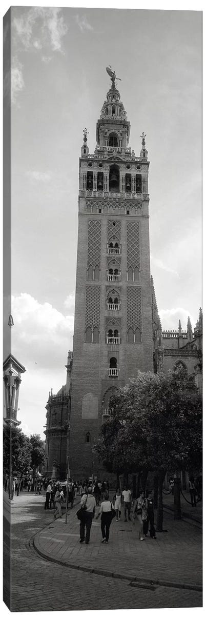 Group of people walking near a church, La Giralda, Seville Cathedral, Seville, Seville Province, Andalusia, Spain Canvas Print #PIM6401