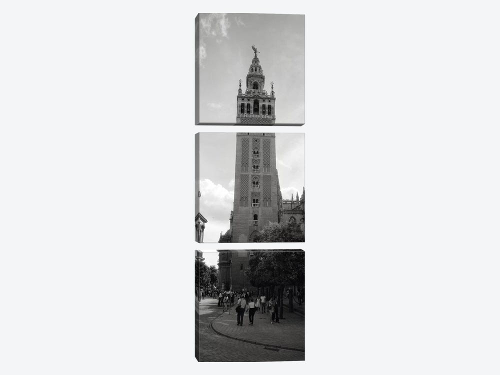 Group of people walking near a church, La Giralda, Seville Cathedral, Seville, Seville Province, Andalusia, Spain by Panoramic Images 3-piece Canvas Art
