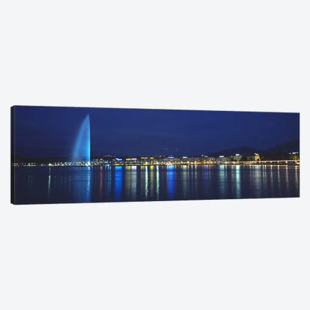Jet d'Eau & Illuminated Buildings Along Quai Gustave-Ador, Geneva, Switzerland Canvas Print #PIM6422} by Panoramic Images Canvas Artwork
