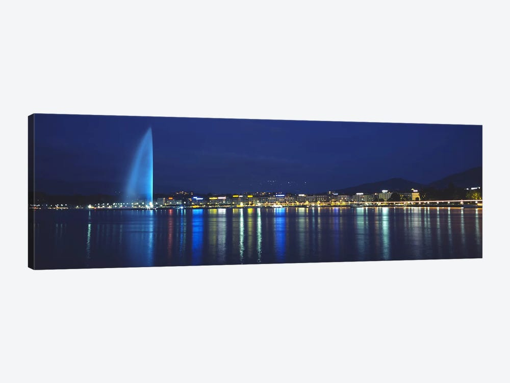 Jet d'Eau & Illuminated Buildings Along Quai Gustave-Ador, Geneva, Switzerland by Panoramic Images 1-piece Art Print