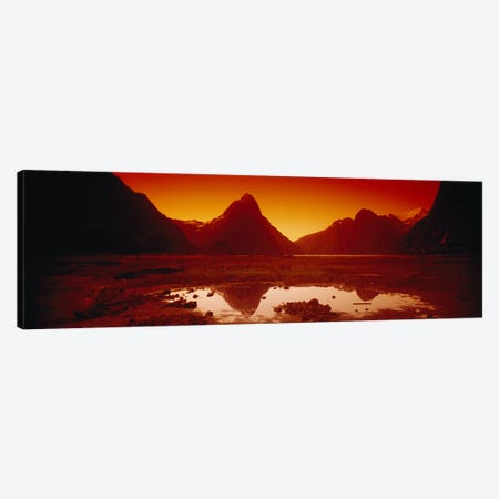 Orangish-Red Sunrise Over Mitre Peak And Milford Sound, South Island, New Zealand Canvas Print #PIM6527} by Panoramic Images Canvas Artwork