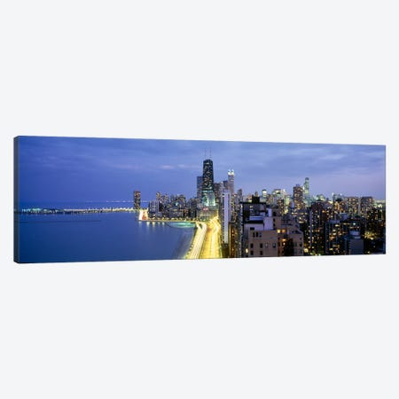 Skyscrapers lit up at the waterfront, Lake Shore Drive, Chicago, Cook County, Illinois, USA Canvas Print #PIM6549} by Panoramic Images Canvas Art Print