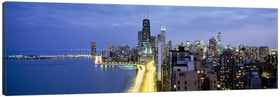 Skyscrapers lit up at the waterfront, Lake Shore Drive, Chicago, Cook County, Illinois, USA Canvas Print #PIM6549