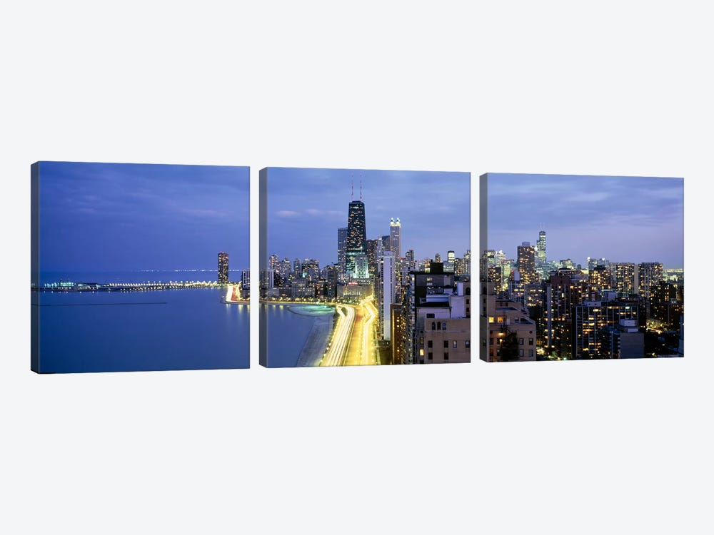 Skyscrapers lit up at the waterfront, Lake Shore Drive, Chicago, Cook County, Illinois, USA by Panoramic Images 3-piece Canvas Print