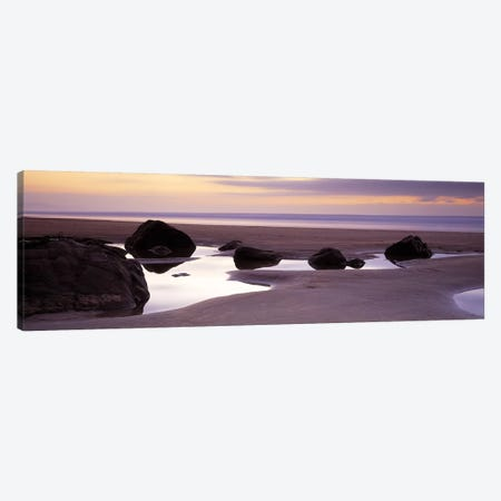 Rocks on the beachSandymouth Bay, Bude, Cornwall, England Canvas Print #PIM6589} by Panoramic Images Canvas Print
