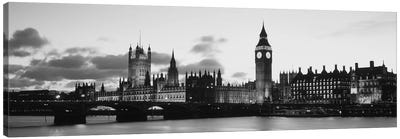 Buildings lit up at dusk, Big Ben, Houses of Parliament, Thames River, City of Westminster, London, England (black & white) Canvas Art Print