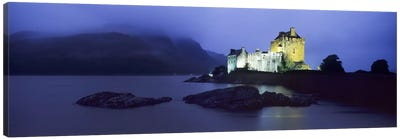 Castle lit up at duskEilean Donan Castle, Loch Duich, Dornie, Highlands Region, Scotland Canvas Art Print