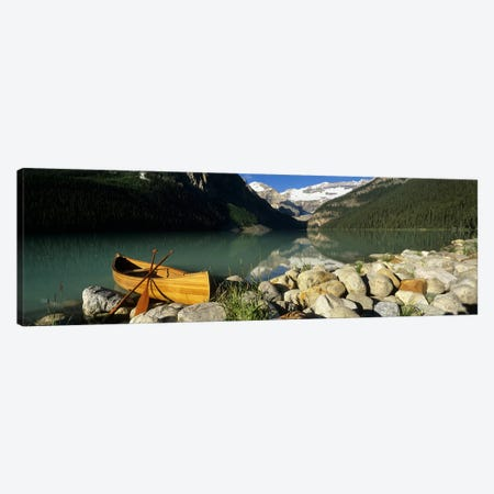 Lone Canoe, Lake Louise, Banff National Park, Alberta, Canada Canvas Print #PIM6616} by Panoramic Images Canvas Artwork