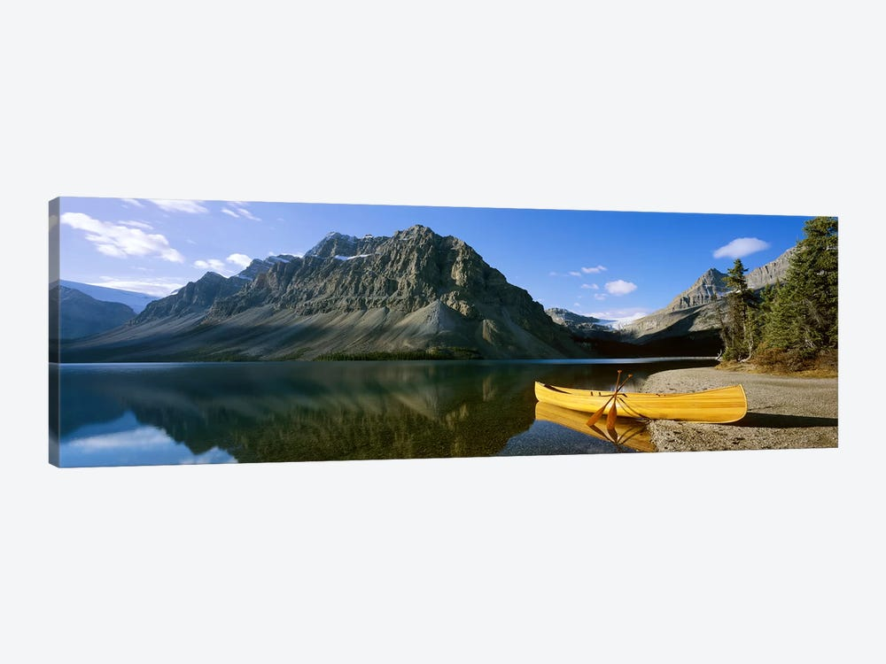Crowfoot Mountain With A Lone Canoe On The Shore Of Bow Lake, Banff National Park, Alberta, Canada by Panoramic Images 1-piece Art Print