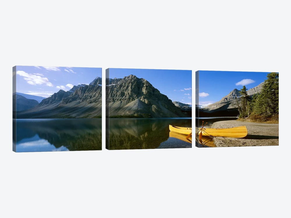 Crowfoot Mountain With A Lone Canoe On The Shore Of Bow Lake, Banff National Park, Alberta, Canada by Panoramic Images 3-piece Art Print