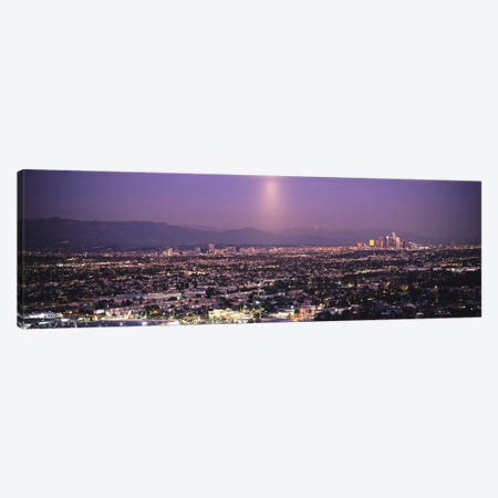 Buildings in a city lit up at dusk, Hollywood, San Gabriel Mountains, City Of Los Angeles, Los Angeles County, California, USA Canvas Print #PIM6636} by Panoramic Images Canvas Wall Art