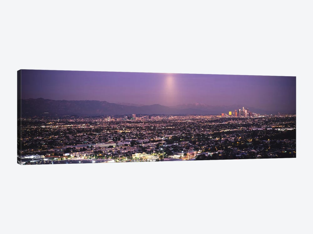 Buildings in a city lit up at dusk, Hollywood, San Gabriel Mountains, City Of Los Angeles, Los Angeles County, California, USA by Panoramic Images 1-piece Canvas Art Print