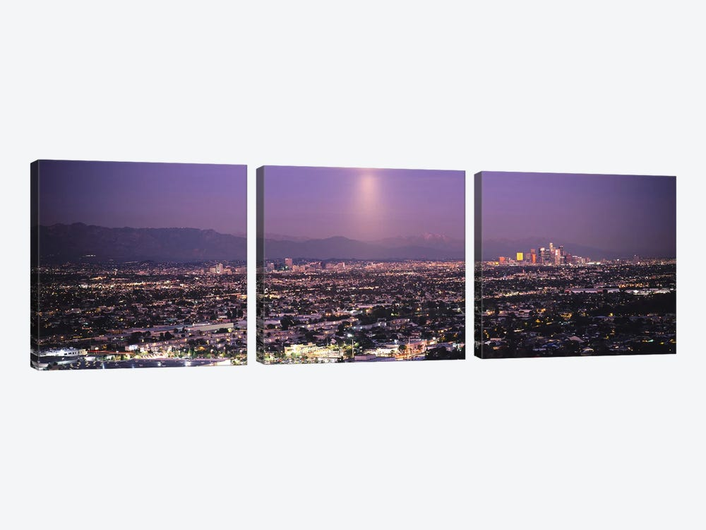 Buildings in a city lit up at dusk, Hollywood, San Gabriel Mountains, City Of Los Angeles, Los Angeles County, California, USA by Panoramic Images 3-piece Canvas Print