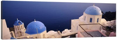 High angle view of blue domed church at the coast, Oia, Santorini, Greece Canvas Art Print