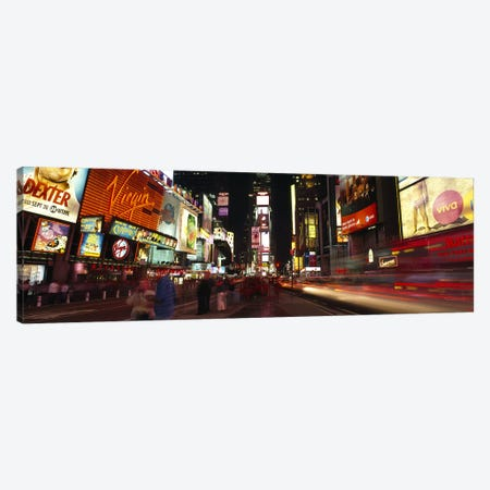 Blurred Motion View Of Nighttime Traffic Along 7th Avenue, Times Square, New York City, New York, USA Canvas Print #PIM6692} by Panoramic Images Canvas Print