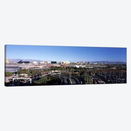 Roads in a city with an airport in the backgroundMcCarran International Airport, Las Vegas, Clark County, Nevada, USA Canvas Print #PIM6697} by Panoramic Images Canvas Artwork