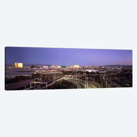 Roads in a city with an airport in the backgroundMcCarran International Airport, Las Vegas, Clark County, Nevada, USA Canvas Print #PIM6699} by Panoramic Images Canvas Art Print