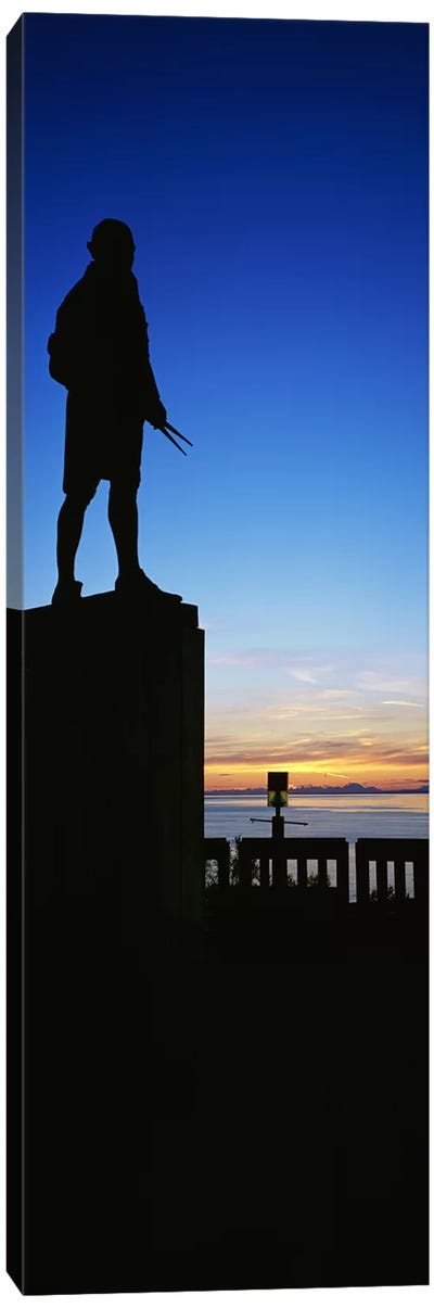 Captain Cook monument silhouetted by sunset, Anchorage, Alaska, USA. Canvas Art Print
