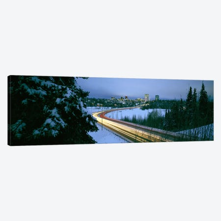 Autumobile lights on busy street, distant city lights, frozen Westchester Lagoon, Anchorage, Alaska, USA. Canvas Print #PIM6726} by Panoramic Images Canvas Art
