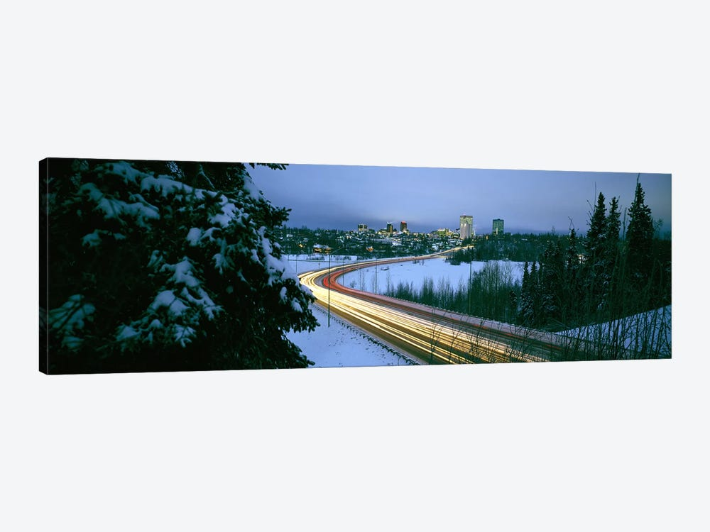 Autumobile lights on busy street, distant city lights, frozen Westchester Lagoon, Anchorage, Alaska, USA. by Panoramic Images 1-piece Art Print