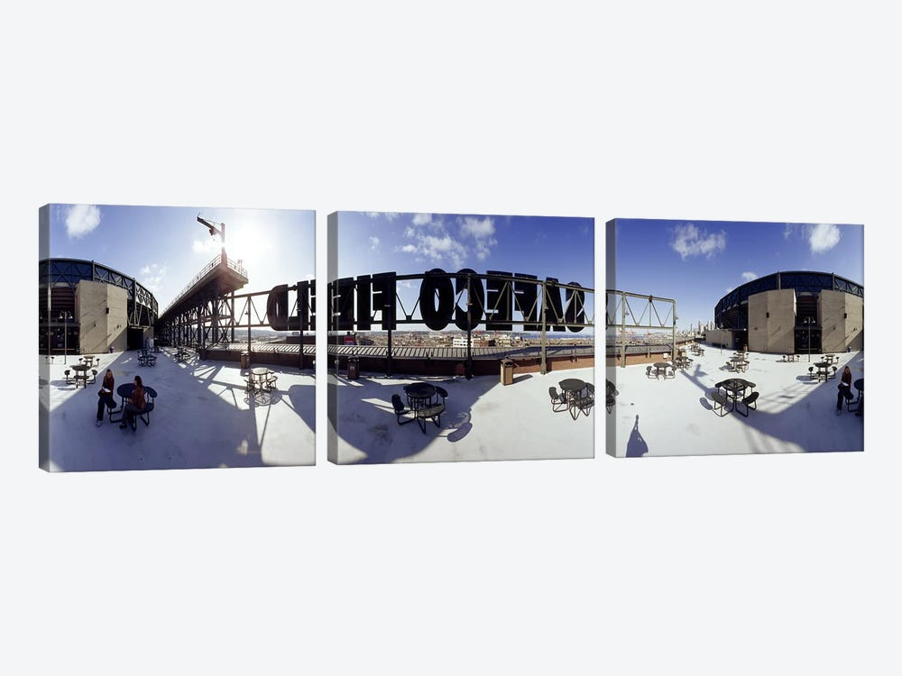 Tourist sitting on a roof outside a baseball stadium, Seattle, King County, Washington State, USA by Panoramic Images 3-piece Art Print