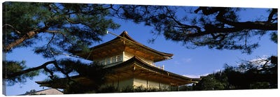 Low angle view of trees in front of a temple, Kinkaku-ji Temple, Kyoto City, Kyoto Prefecture, Kinki Region, Honshu, Japan Canvas Art Print