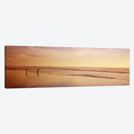 Two children playing on the beach, San Francisco, California, USA Canvas Print #PIM6999} by Panoramic Images Canvas Wall Art