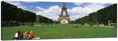 Tourists sitting in a park with a tower in the background, Eiffel Tower, Paris, Ile-de-France, France Canvas Print #PIM7020