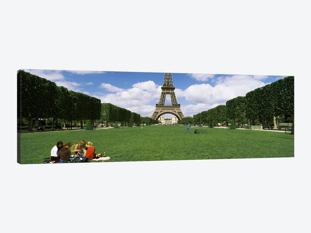 Tourists sitting in a park with a tower in the background, Eiffel Tower, Paris, Ile-de-France, France by Panoramic Images 1-piece Canvas Art