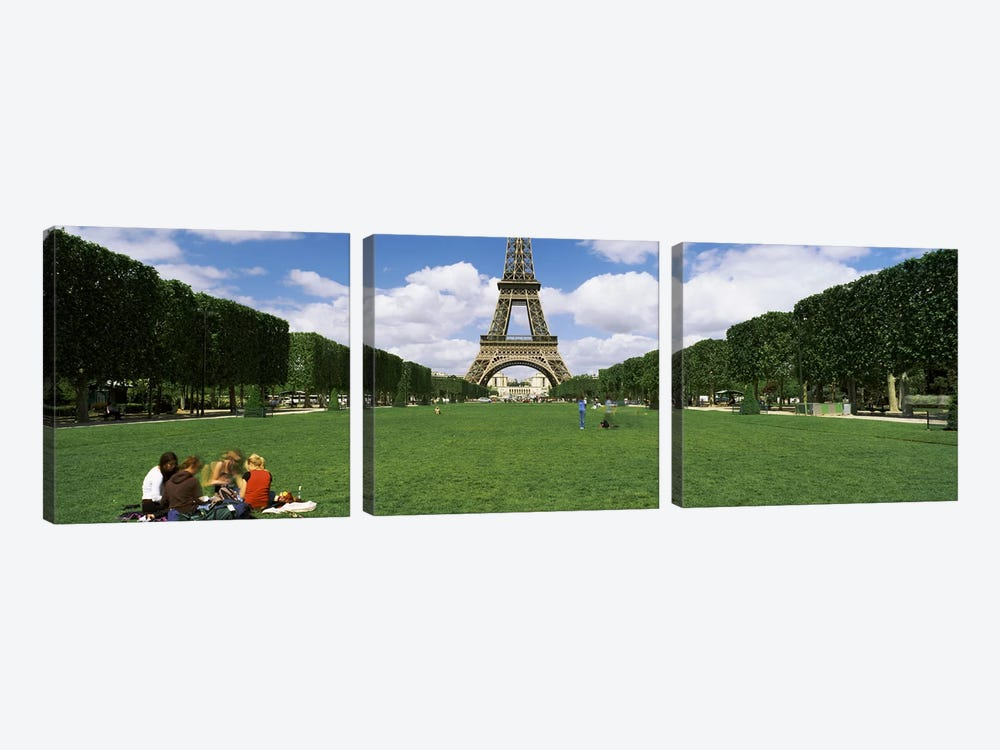 Tourists sitting in a park with a tower in the background, Eiffel Tower, Paris, Ile-de-France, France by Panoramic Images 3-piece Canvas Artwork