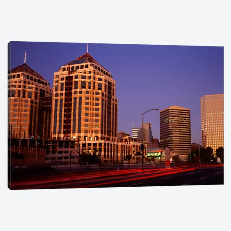 USA, California, Oakland, Alameda County, New City Center, Buildings lit up at night Canvas Print #PIM703} by Panoramic Images Art Print