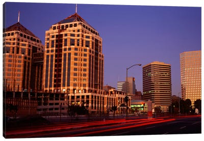 USA, California, Oakland, Alameda County, New City Center, Buildings lit up at night Canvas Art Print