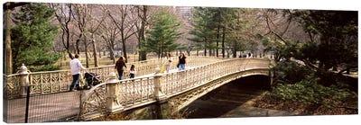 Group of people walking on an arch bridgeCentral Park, Manhattan, New York City, New York State, USA Canvas Print #PIM7125