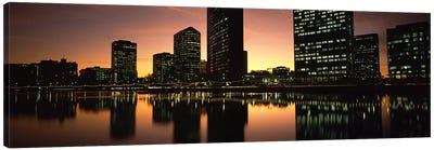Buildings lit up at dusk, Oakland, Alameda County, California, USA Canvas Art Print