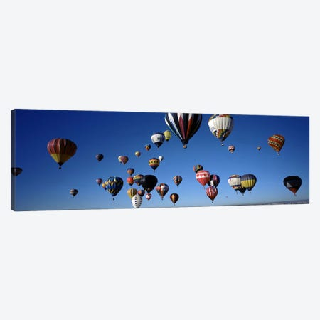 Hot air balloons floating in skyAlbuquerque International Balloon Fiesta, Albuquerque, Bernalillo County, New Mexico, USA Canvas Print #PIM7162} by Panoramic Images Canvas Art