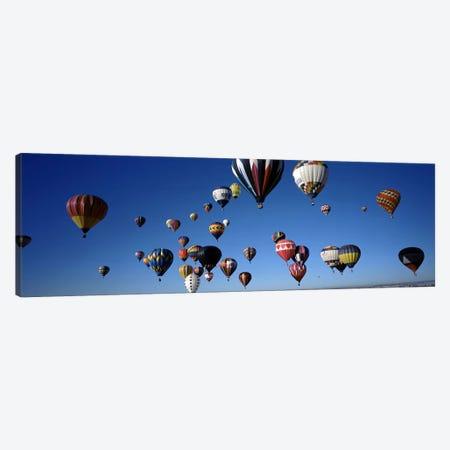 Hot air balloons floating in skyAlbuquerque International Balloon Fiesta, Albuquerque, Bernalillo County, New Mexico, USA Canvas Print #PIM7162} by Panoramic Images Canvas Art