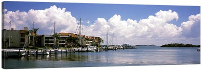 Boats docked in a bay, Cabbage Key, Sunshine Skyway Bridge in Distance, Tampa Bay, Florida, USA Canvas Art Print