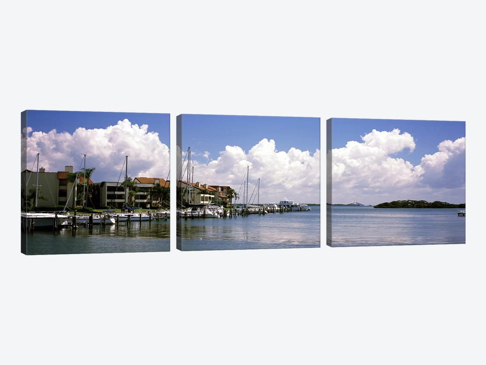 Boats docked in a bay, Cabbage Key, Sunshine Skyway Bridge in Distance, Tampa Bay, Florida, USA 3-piece Canvas Art Print