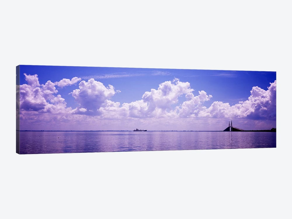 Sea with a container ship and a suspension bridge in distant, Sunshine Skyway Bridge, Tampa Bay, Gulf of Mexico, Florida, USA by Panoramic Images 1-piece Canvas Artwork