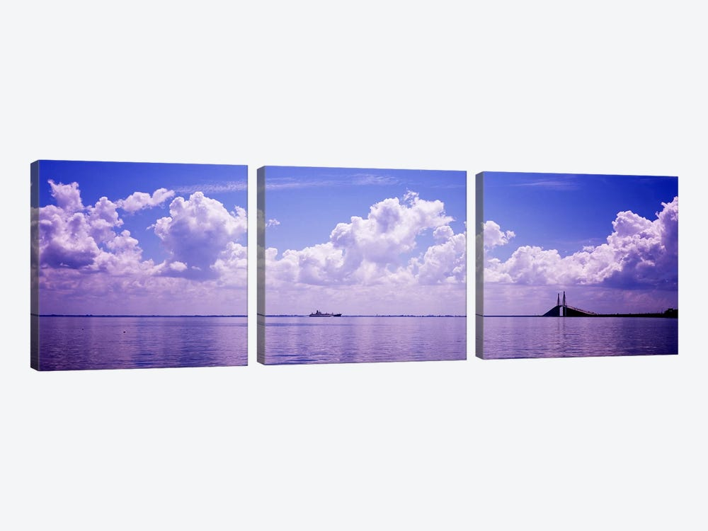 Sea with a container ship and a suspension bridge in distant, Sunshine Skyway Bridge, Tampa Bay, Gulf of Mexico, Florida, USA by Panoramic Images 3-piece Canvas Art