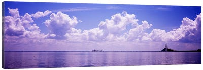 Sea with a container ship and a suspension bridge in distant, Sunshine Skyway Bridge, Tampa Bay, Gulf of Mexico, Florida, USA Canvas Art Print